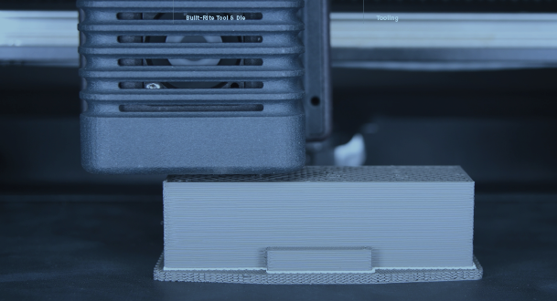 Desktop Metal's Studio System printing the insert layer by layer using Bound Metal Deposition technology