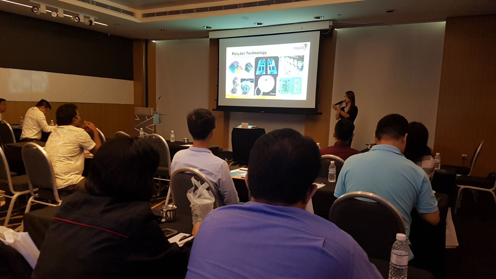 Ms. Sally Chuen presenting on how Additive Manufacturing has moved beyond prototyping
