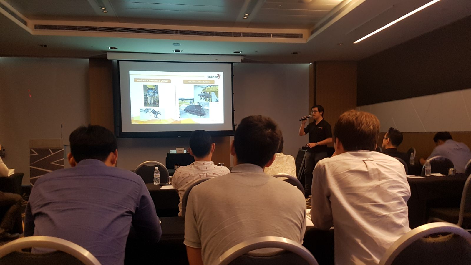 Mr. Cheong Zhi Sheng of Creatz3D presenting on the synergy between 3D printing and end-of-arm-tooling
