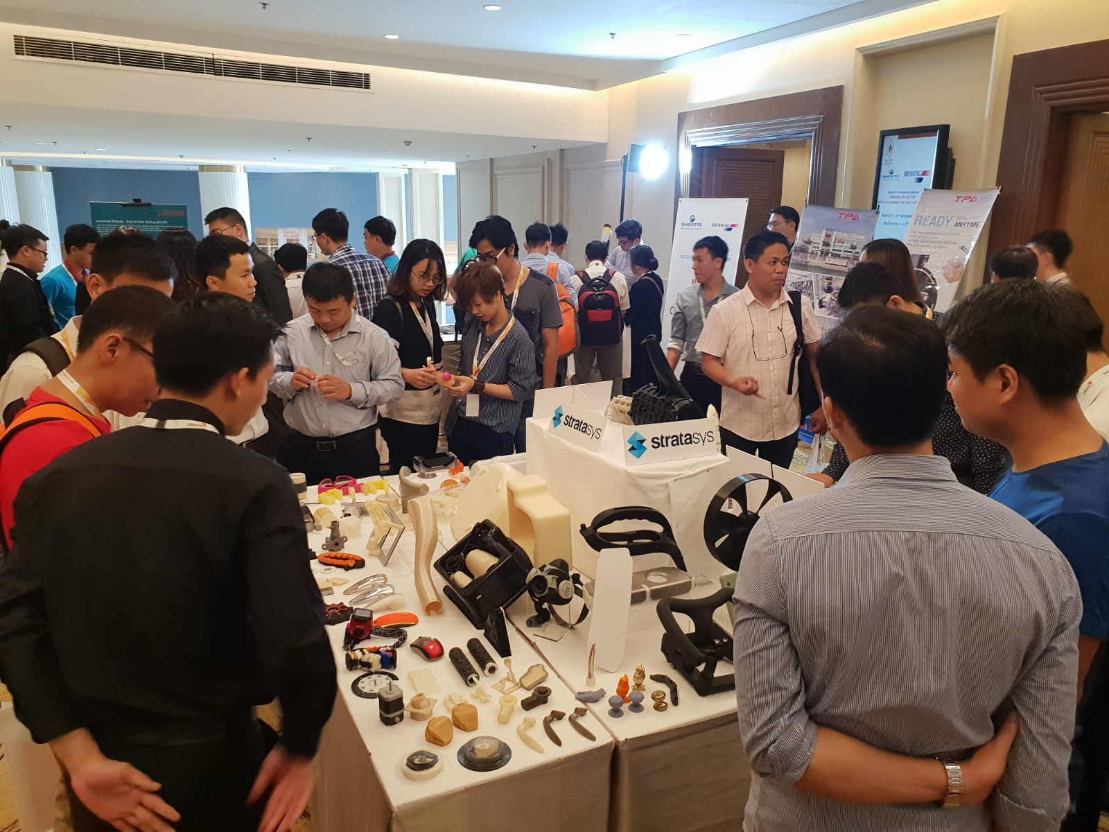 Attendees viewing 3D printed samples