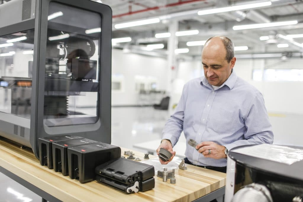 Harold Sears, additive manufacturing technical leader at Ford's Advanced Manufacturing Center, studies 3D printed parts printed with Desktop Metal's Studio System+.
