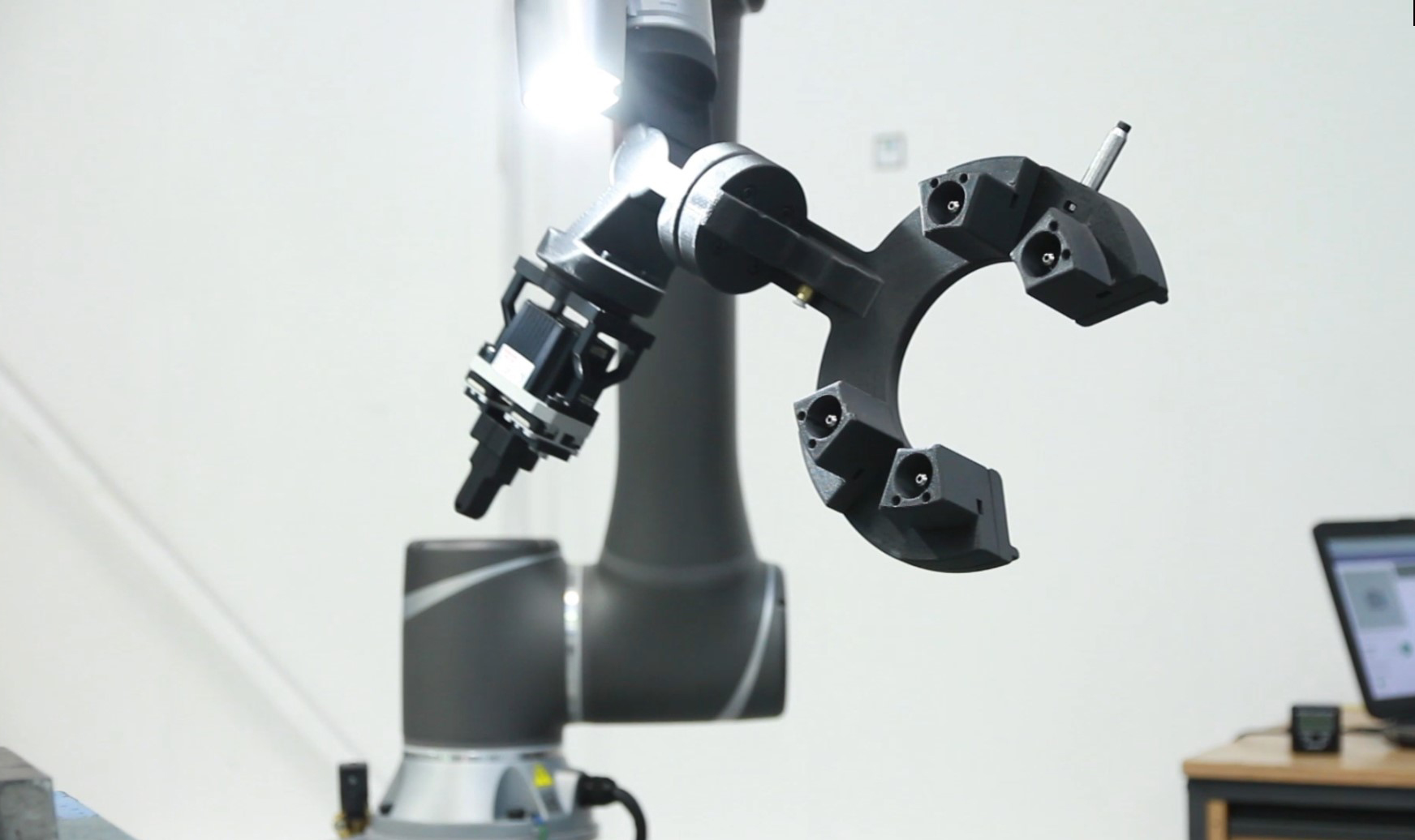 End-of-arm tooling produced on the Fortus 380CF in action on a robotic arm.