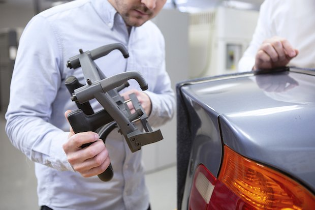 BMW has replaced aluminum fixtures with FDM 3D printed ABS thermoplastic fixtures.