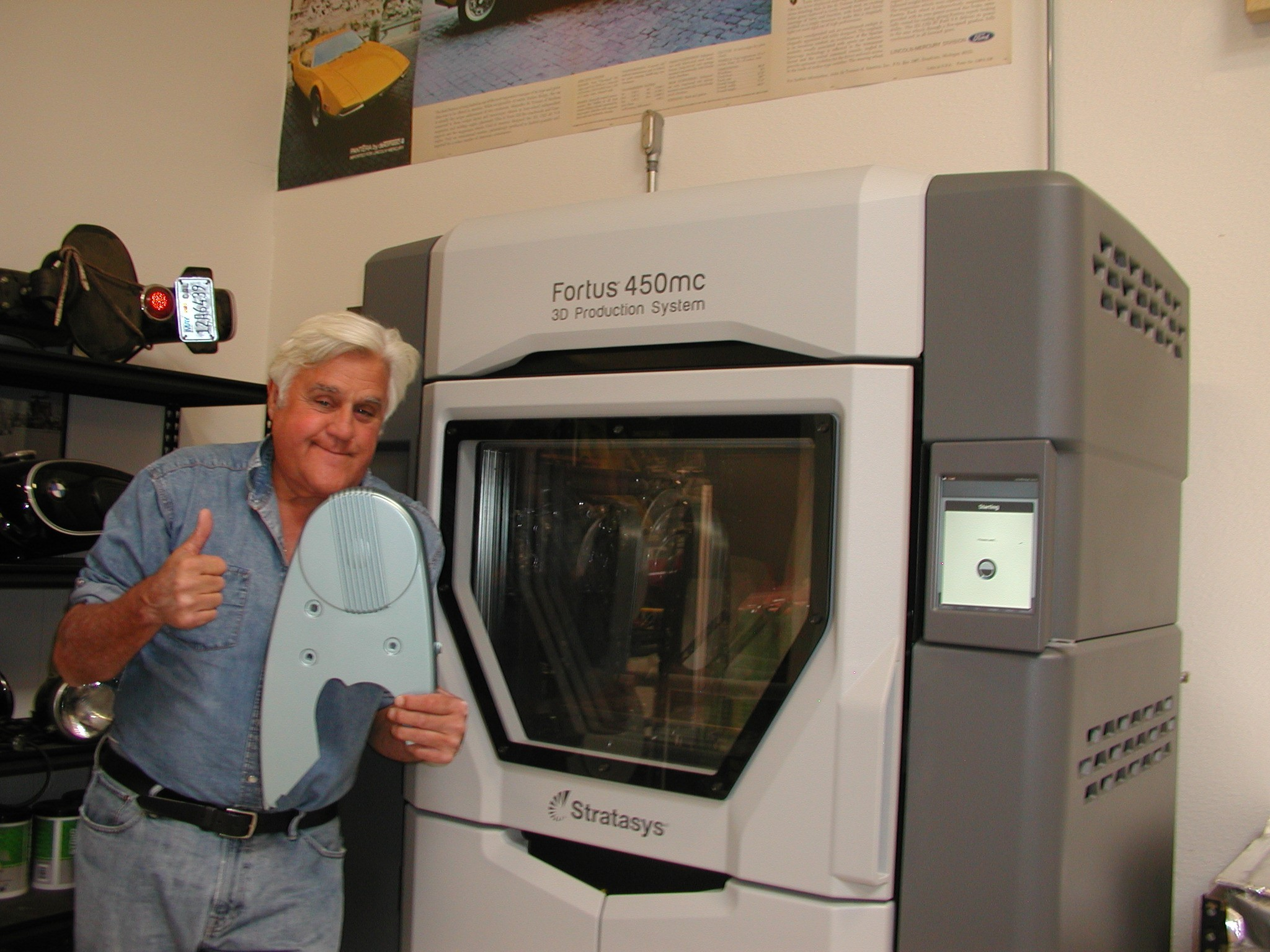 Jay Leno poses with 3D printed part fabricated from Stratasys Fortus 450mc.