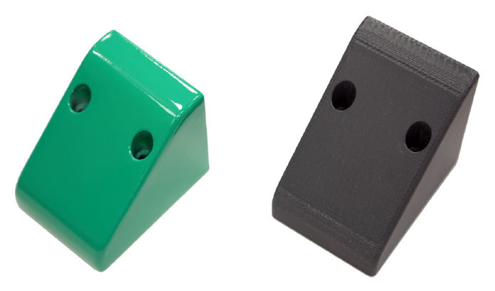 Strong, yet lightweight 3D printed protective casing used on robotic packaging machines. Produced with the Stratasys Fortus 450mc in FDM Nylon 12CF material and finished with green varnish.