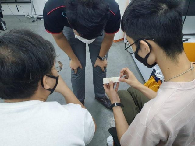 Examining a 3D printed part.