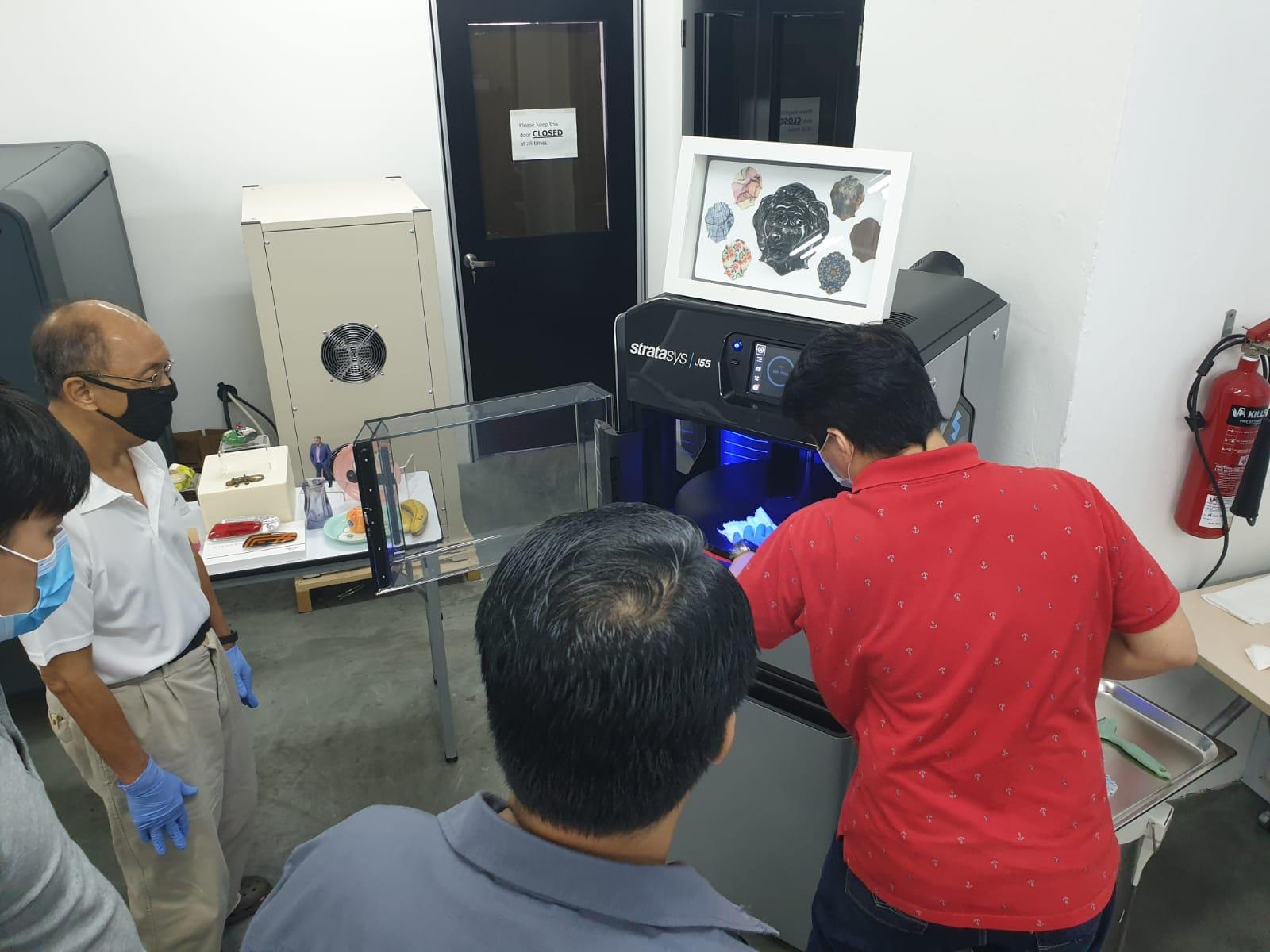 Showing the Stratasys J55 print tray with printed parts.