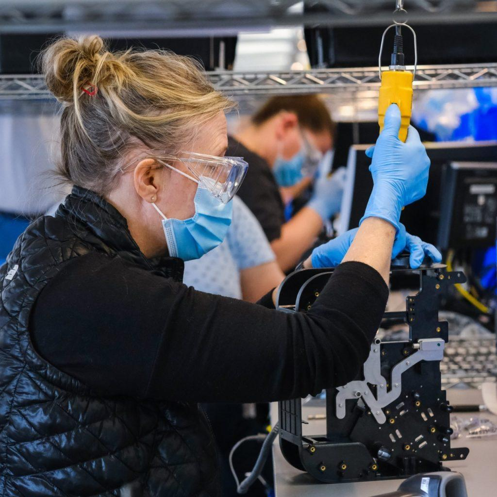 Workers build production ventilators at the General Motors manufacturing facility in Kokomo, Indiana, Tuesday, April 28, 2020. GM and Ventec Life Systems are partnering to produce VOCSN critical care ventilators in response to the COVID-19 pandemic. (Photo by AJ Mast for General Motors)