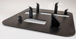 3D printed using ULTEM 9085 resin, this X-ray guide is used to ensure automotive sensors are kept in place during production and to guarantee product repeatability.